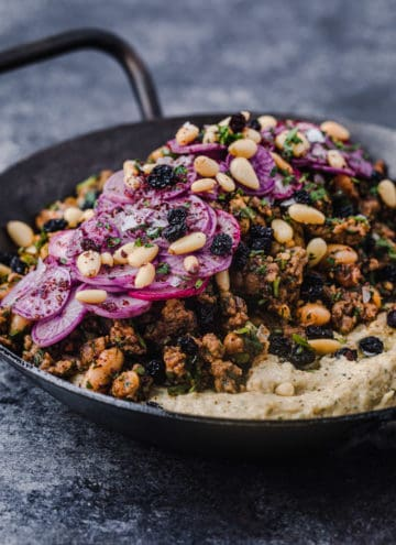 side angle and up close shot of hummus topped with spiced ground lamb.