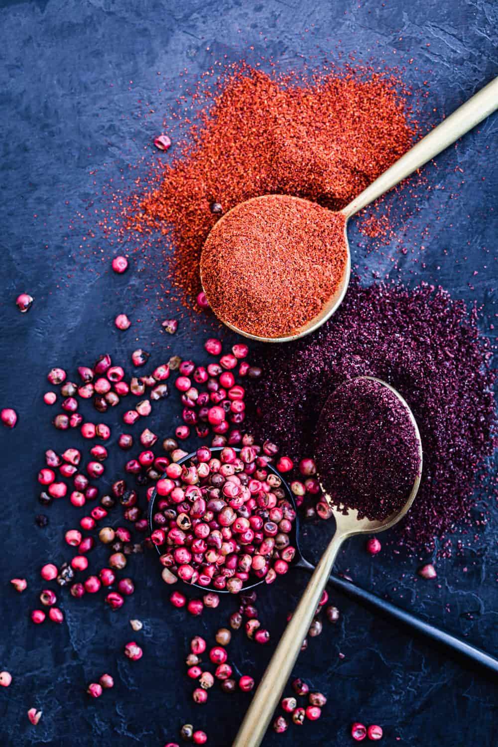 ingredient shot of sumac, paprika and pink peppercorns