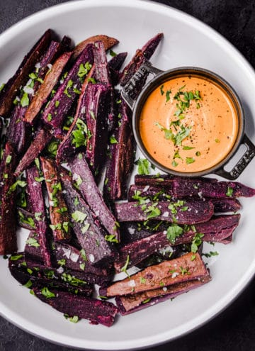 sweet potato fries served on a platter with chipotle aioli