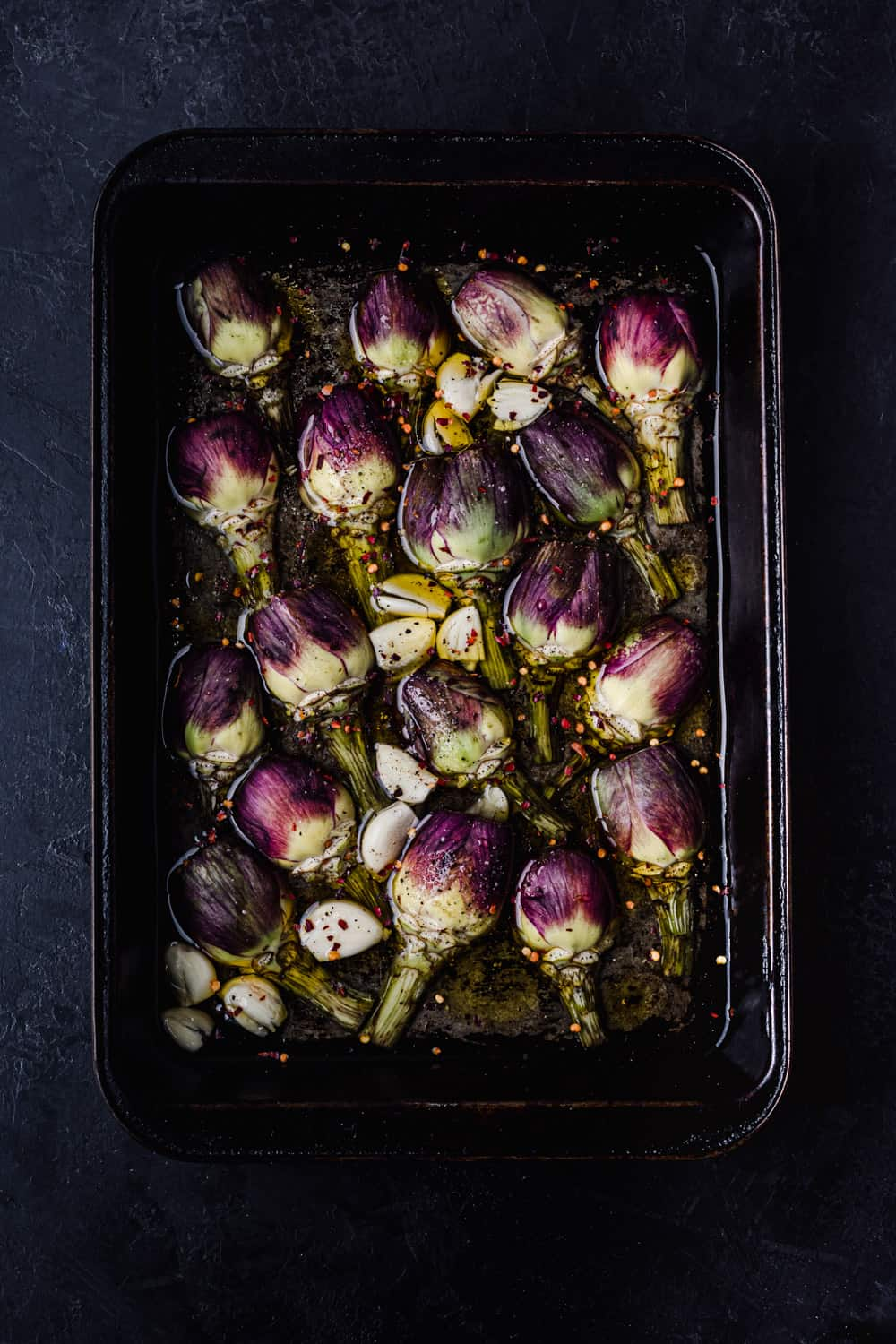 Artichokes with lemon, white wine, water, olive oil, garlic, chili flakes, salt and pepper.