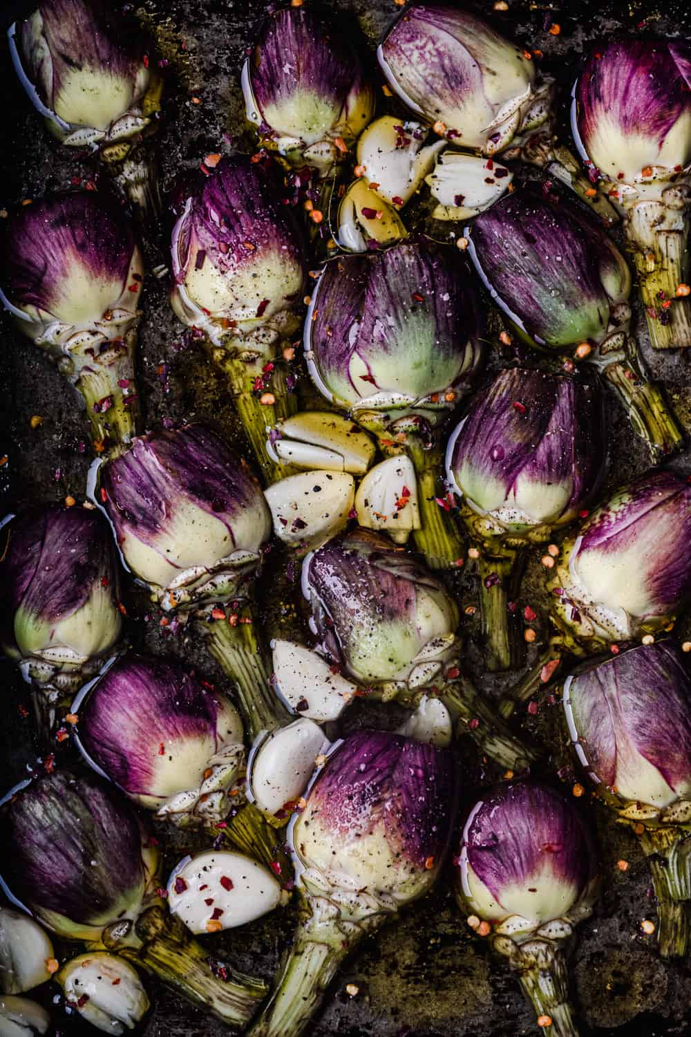 Close up prep shot of artichokes in spicy-garlicky-white wine