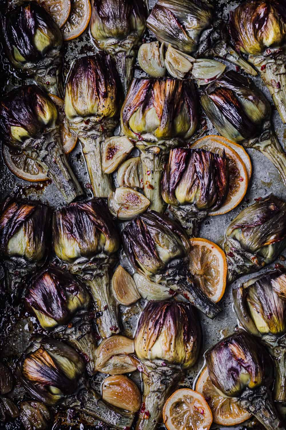 Post oven shot of the roasted artichokes with garlic and lemon slices