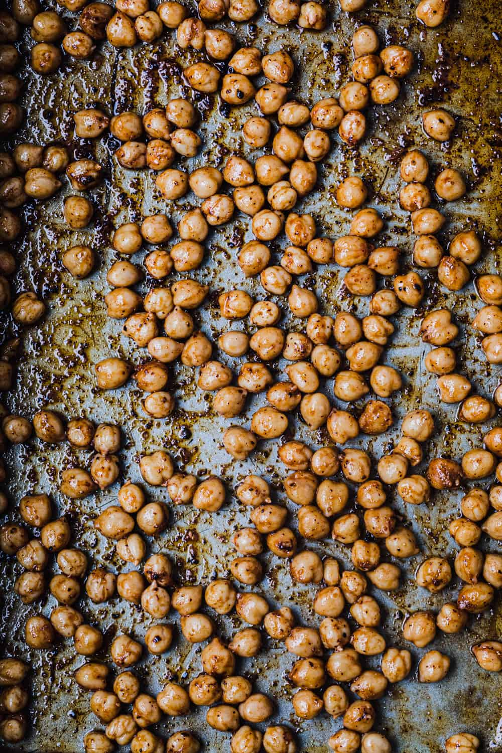 crispy chickpeas, also called garbanzo beans, in process and pre-oven shot