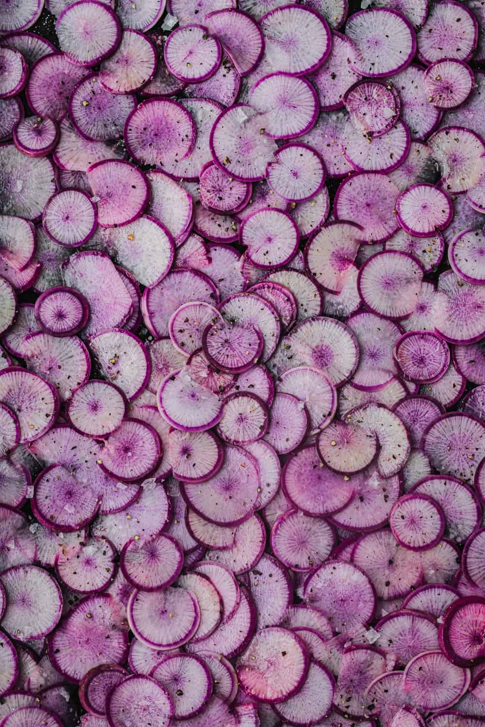 thinly sliced purple ninja radishes, overhead shot