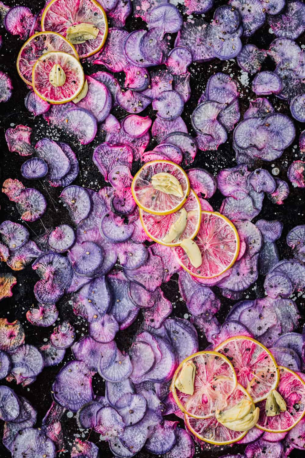 oven roasted purple ninja radishes just out of the oven, overhead shot
