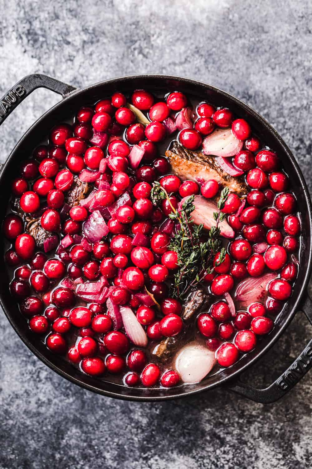 In process shot of Fresh Cranberry and Red Wine Short ribs - pre-braising in the oven