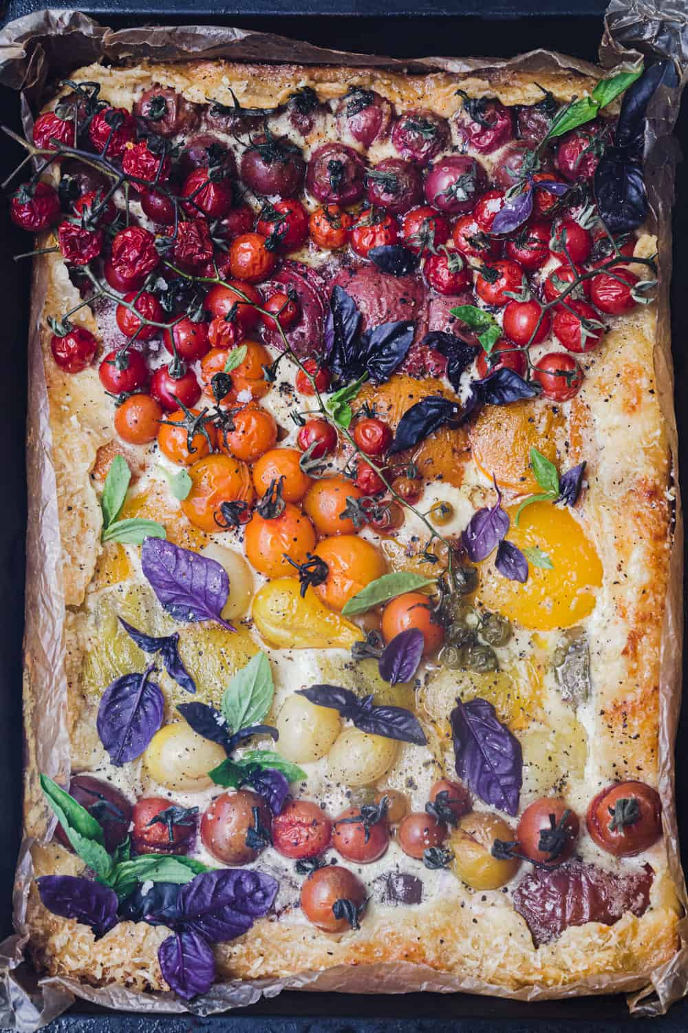 Heirloom tomato tart post oven and topped with purple basil! The topping create a tomato rainbow!