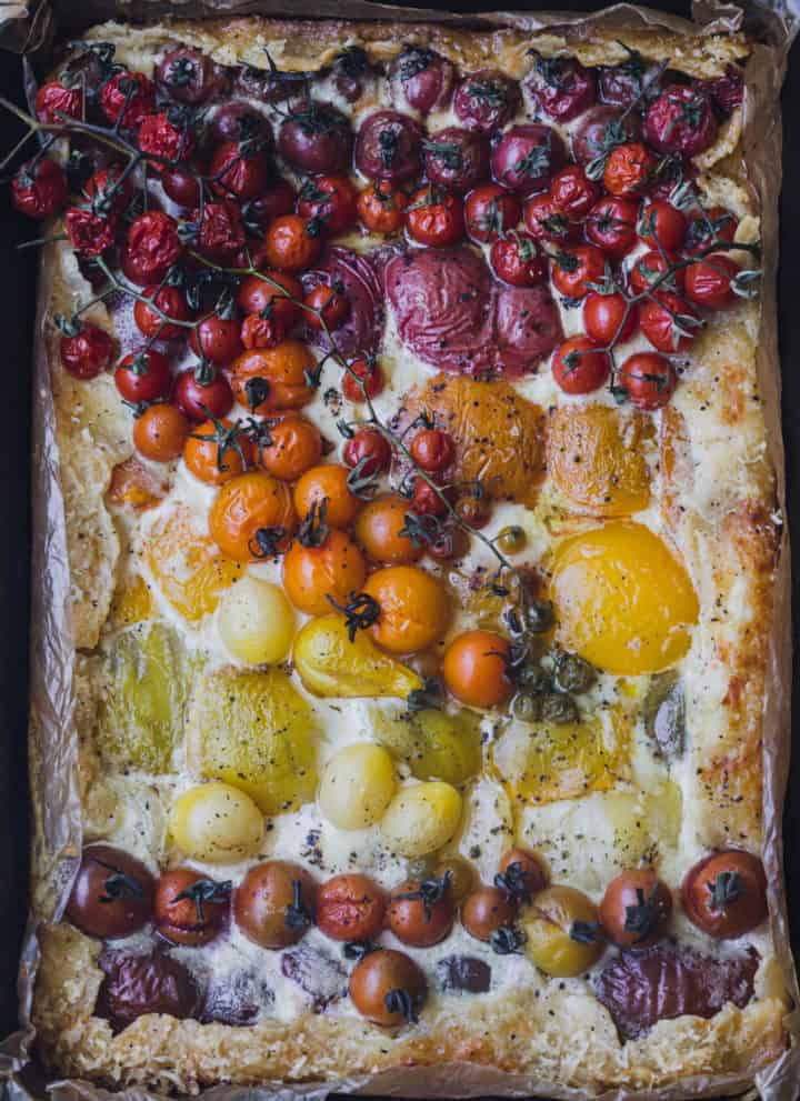 Heirloom tomato galette post oven! The tomatoes are arranged like a rainbow.