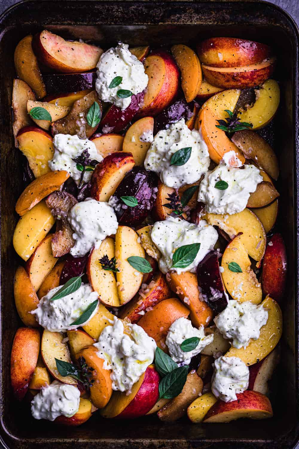 Stone Fruit & Burrata salad with mint and balsamic vinaigrette. There's peaches, nectarines and plums.