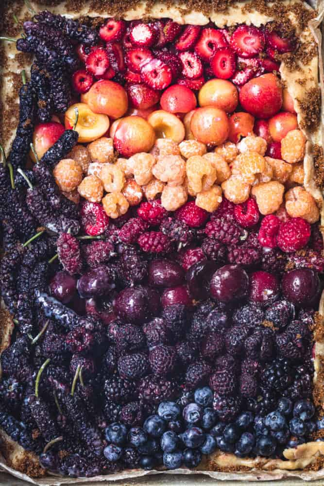 Pre-oven and close up shot of mixed berry galette! There' strawberries, raspberries, cherries, mulberries, blueberries and tayberries in the berry mix.