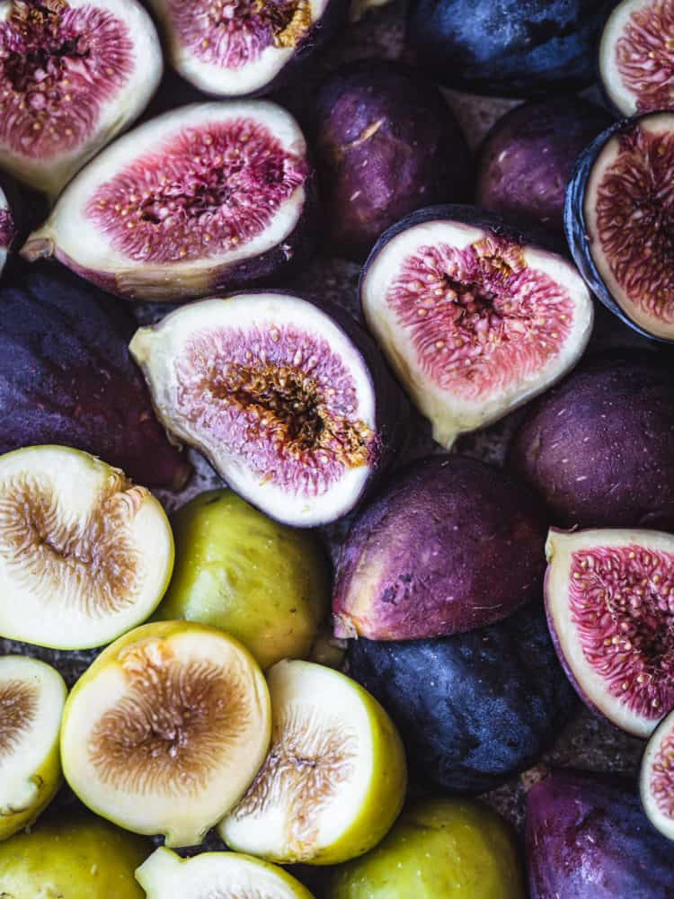3 varieties of figs! There's fresh purple and green figs, cut in half, up close and over head shot.