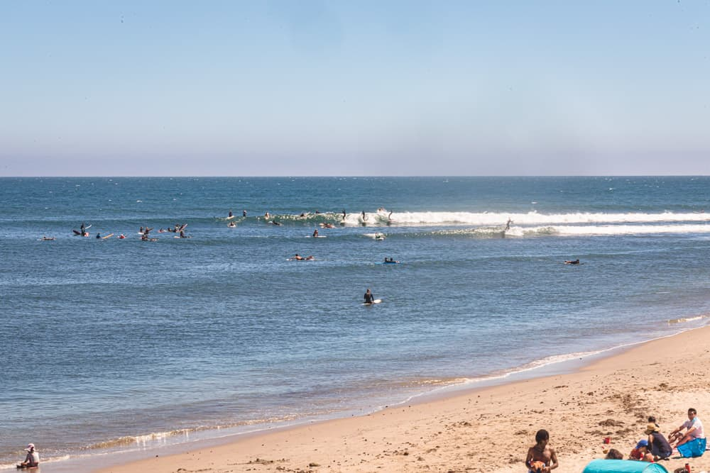 Surfers in Los Angeles! Many surfers sharing a waves at first point in Malibu Beach.