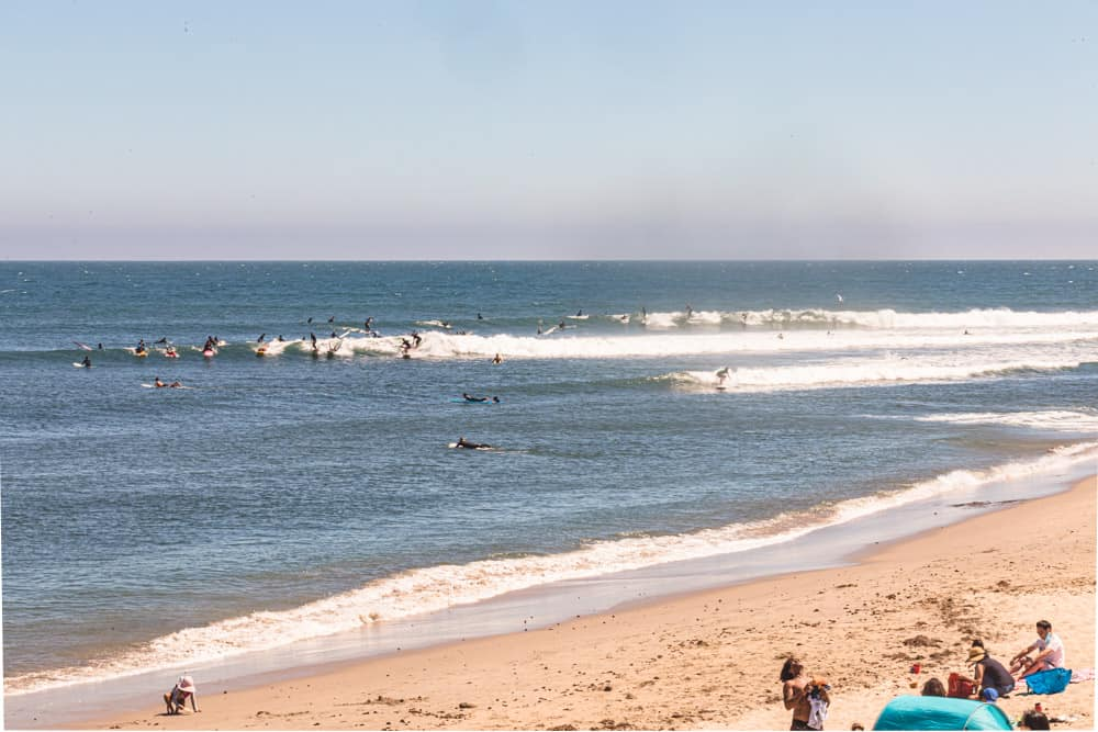 Surfers in Los Angeles! Lots of surfers sharing a wave at surfrider beach in Malibu.
