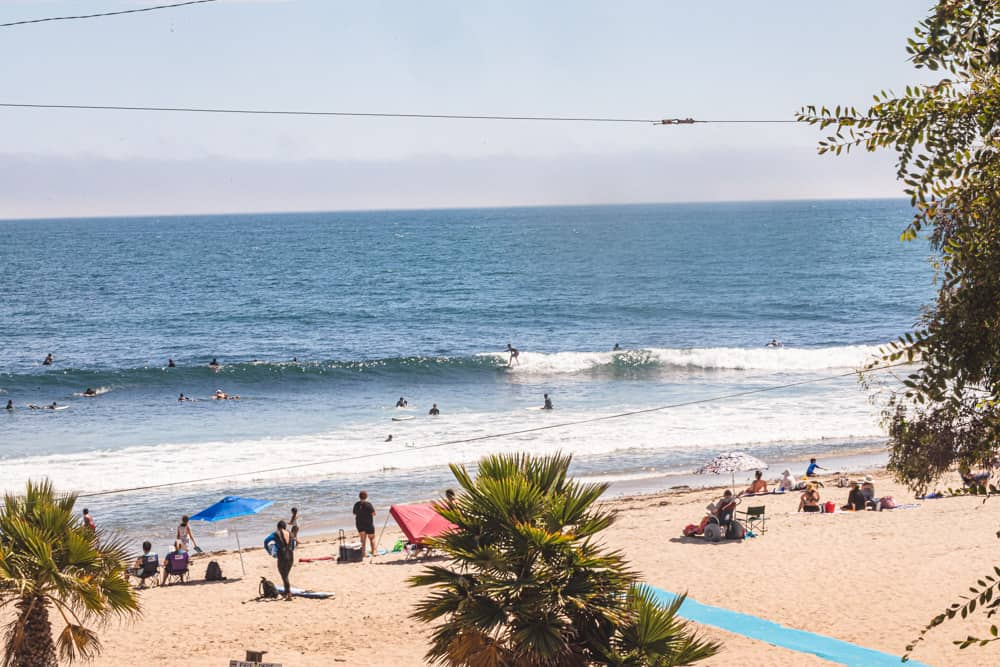 Surfers in Los Angeles! The surf, waves and beach at Topanga beach.
