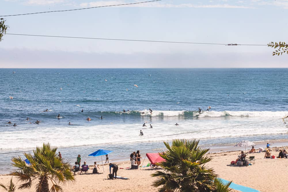 Surfers in LA! Topanga beach - the waves with surfers and them and some sunbathers.
