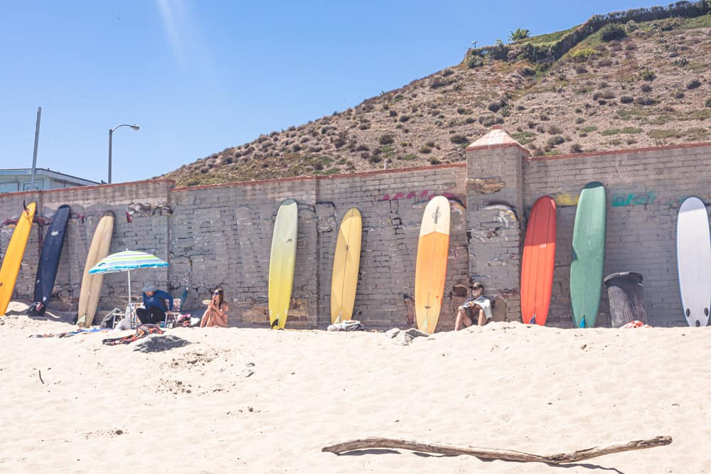 Malibu - surfrider beach - colorful longboards leaning up against the wall.