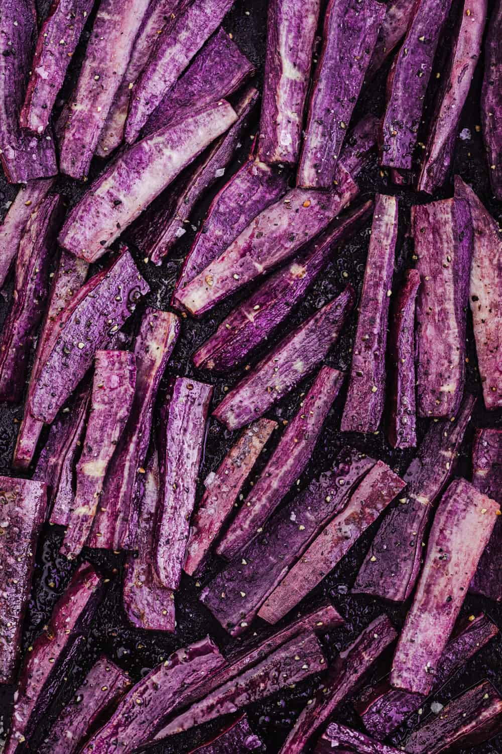 Post oven purple sweet potato wedge shot; taken overhead.