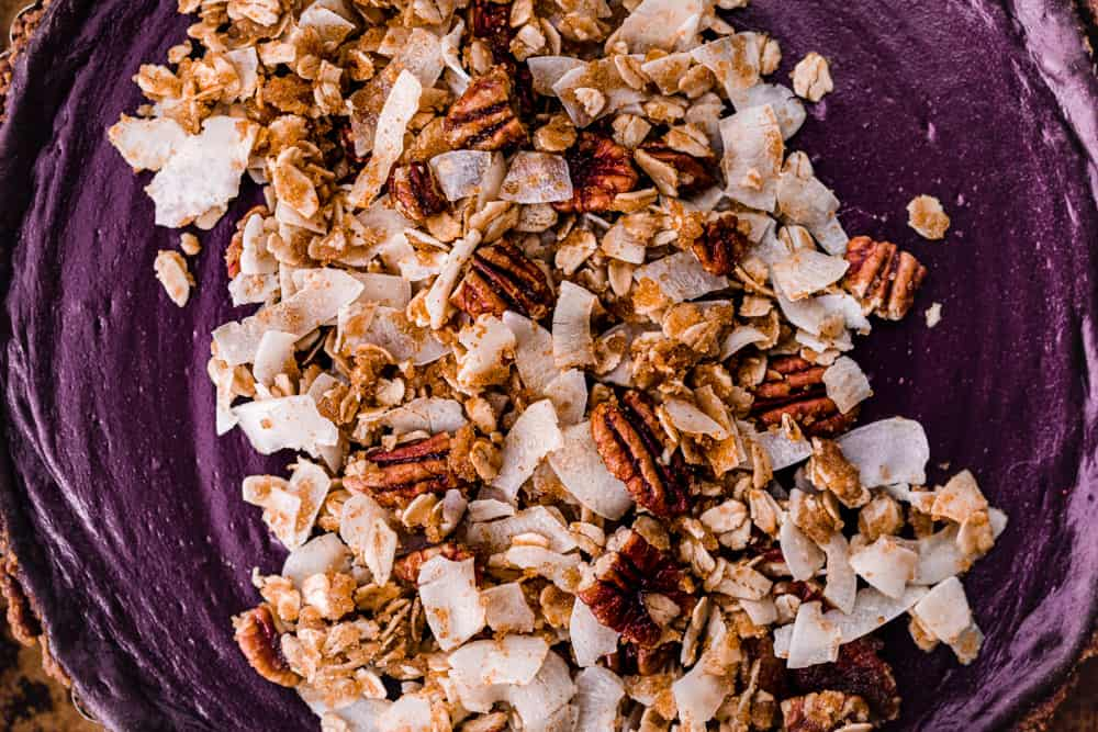 Up close shot of the spiced pecan-coconut streusel on top of the purple sweet potato pie.