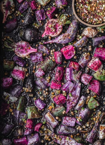 Sumac roasted radishes topped with pistachio dukkah! Overhead shot and there's a little bowl with extra pistachio dukkah on the top right corner.