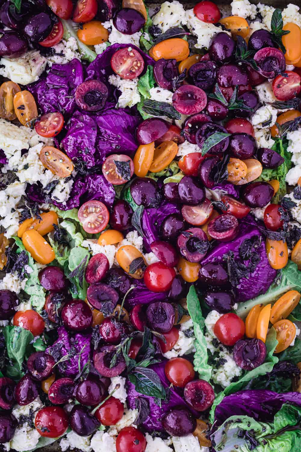 Cherry & Cherry Tomato Summer Salad with purple cabbage, greens and baked feta.