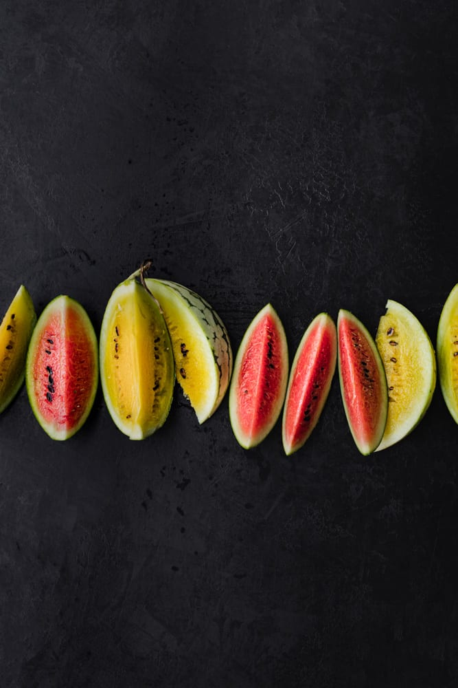 slices of pink and yellow mini watermelons